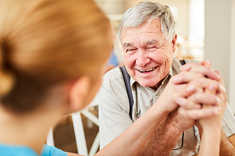 assisted living nurse helping patient